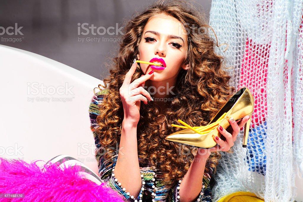 Sensual inimitable woman eating sticks stock photo