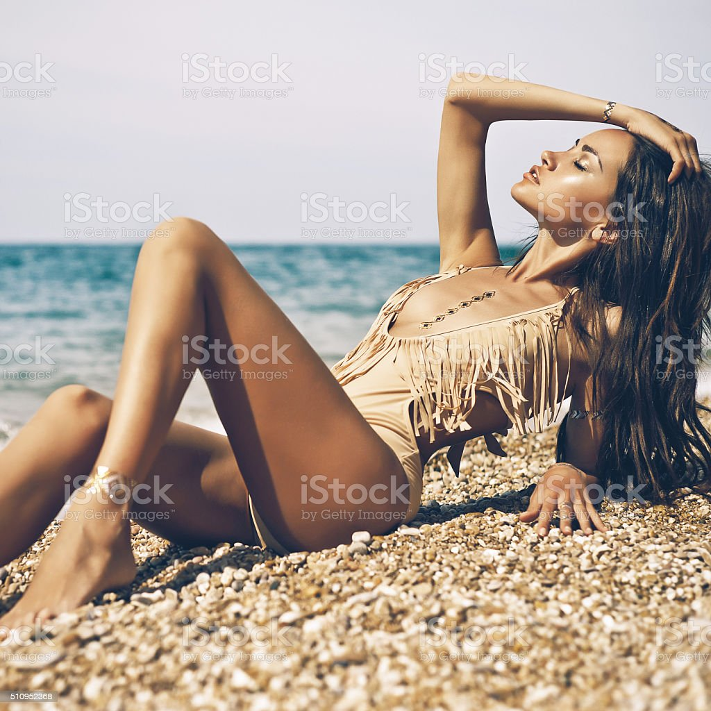 Sensual lady at beach stock photo