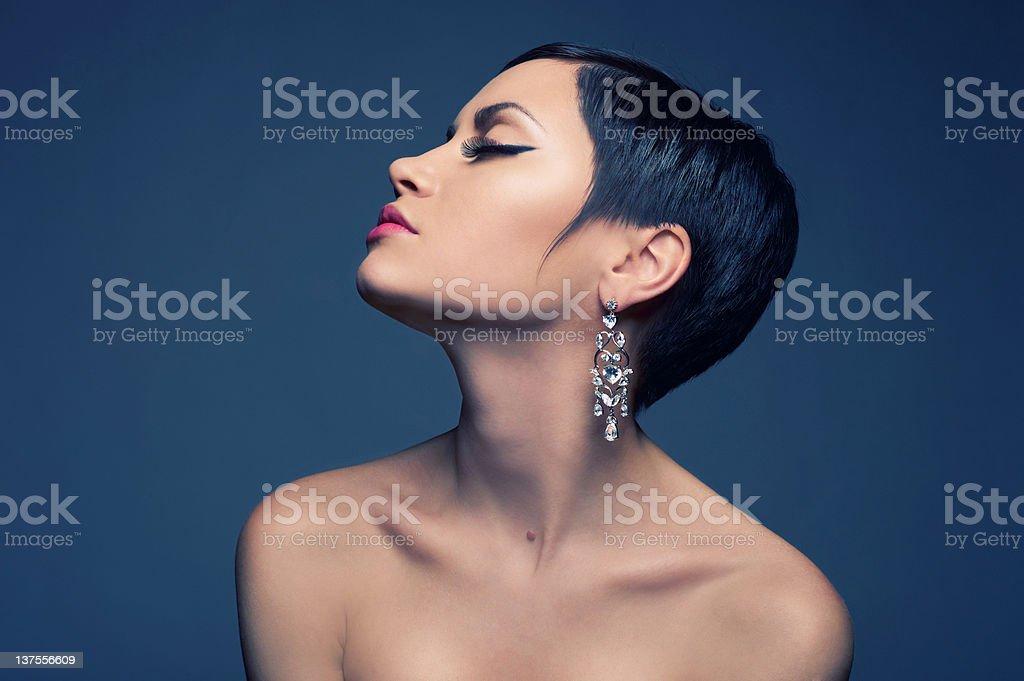 Sensual lady with diamond earring royalty-free stock photo