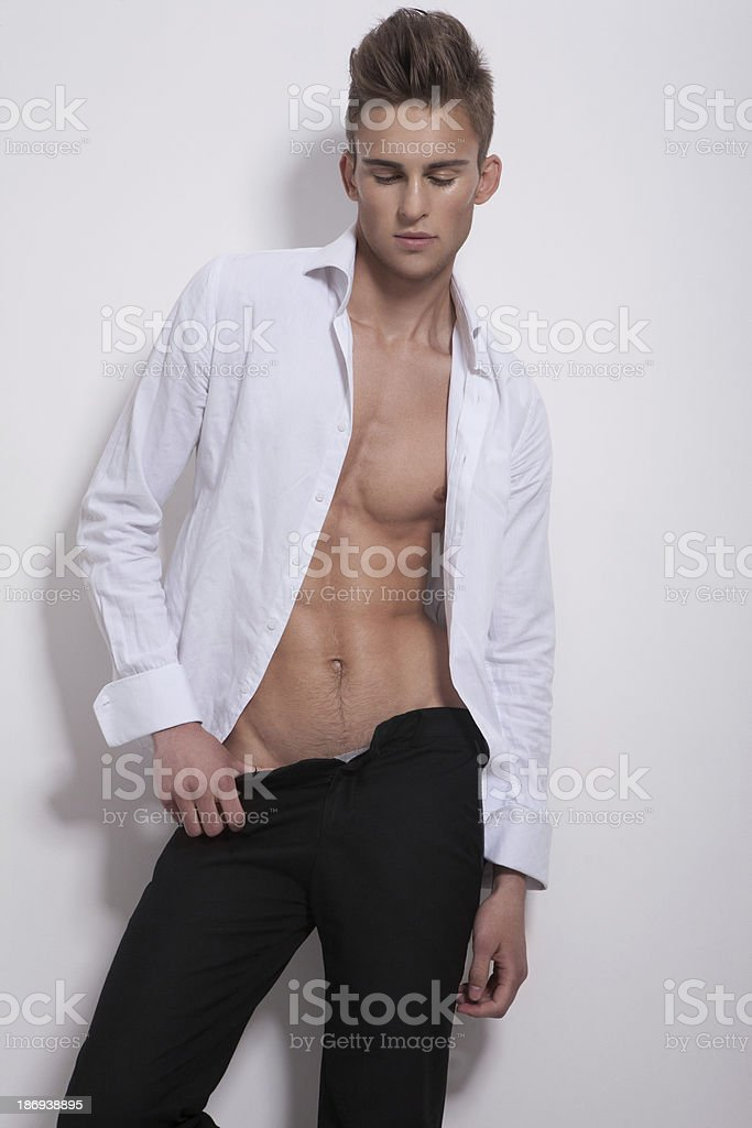 Sensual man in white unbuttoned shirt stock photo