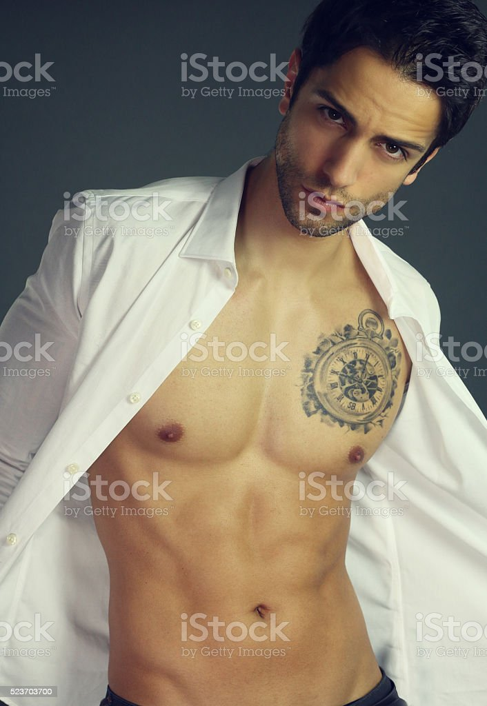 Sensual man with open shirt stock photo
