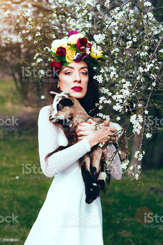 Sensual portrait of a spring woman with goat stock photo