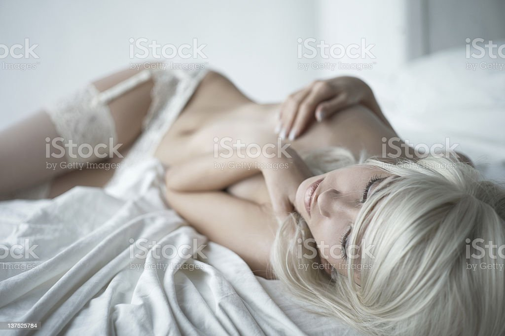 Sensual woman in bed royalty-free stock photo