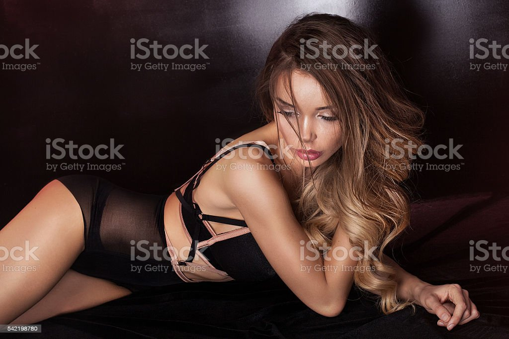Sensual woman in lingerie lying. stock photo