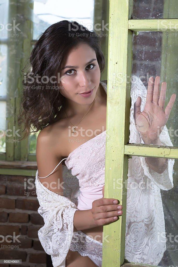 Sensual woman in window stock photo