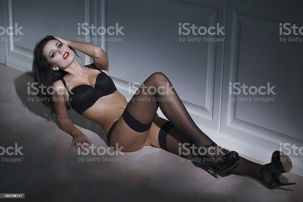 Sensual woman laying on the floor royalty-free stock photo