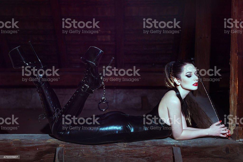 Sensual woman laying on timber at night royalty-free stock photo
