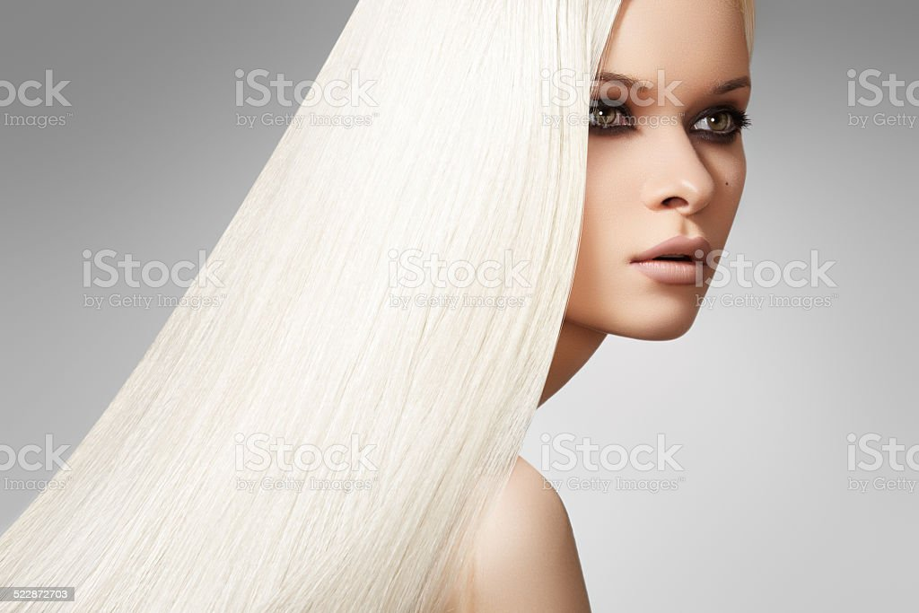 Sensual woman model with shiny straight long blond hair & make-up stock photo