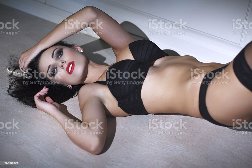 Sensual woman posing on floor royalty-free stock photo