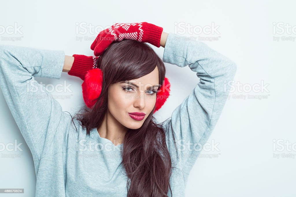 Sensual woman wearing earmuffs stock photo