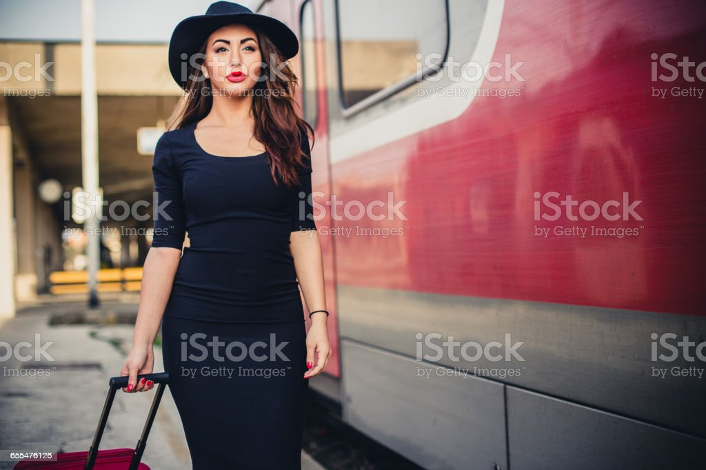 Sensual woman with a hat waiting the train stock photo