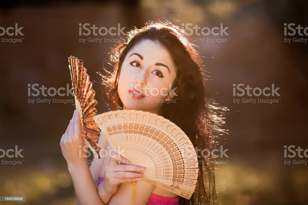 sensual woman with fan royalty-free stock photo