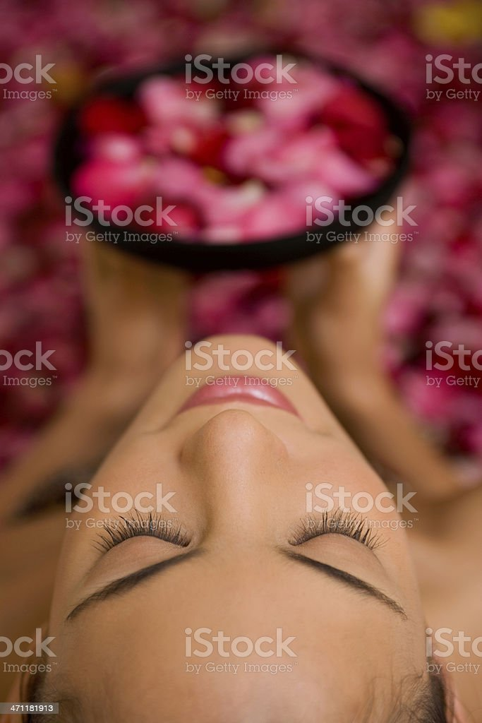 Sensual Woman With Flowers In A Spa Bath royalty-free stock photo