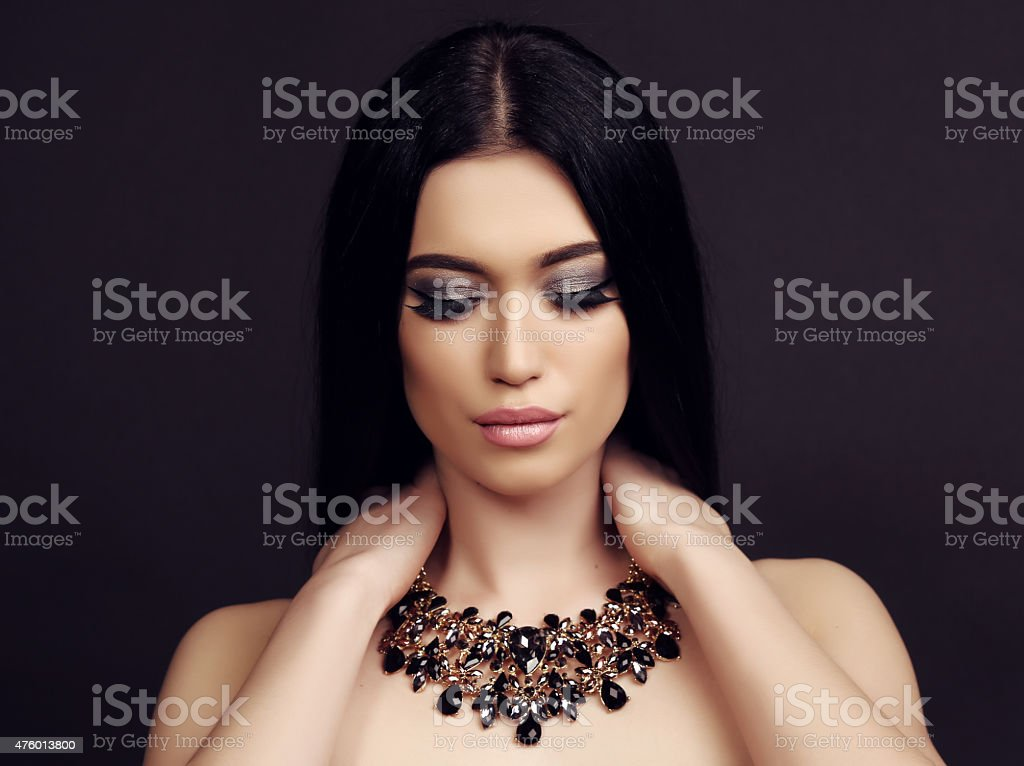 sensual woman with long dark hair with luxurious bijou necklace stock photo