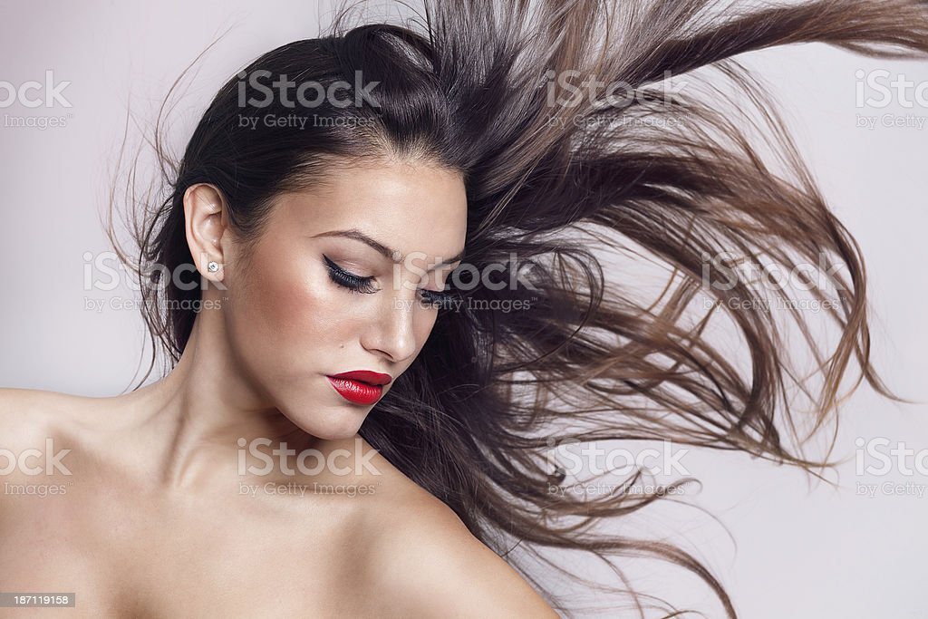 sensual woman with luxurious red lips and wind in hair royalty-free stock photo
