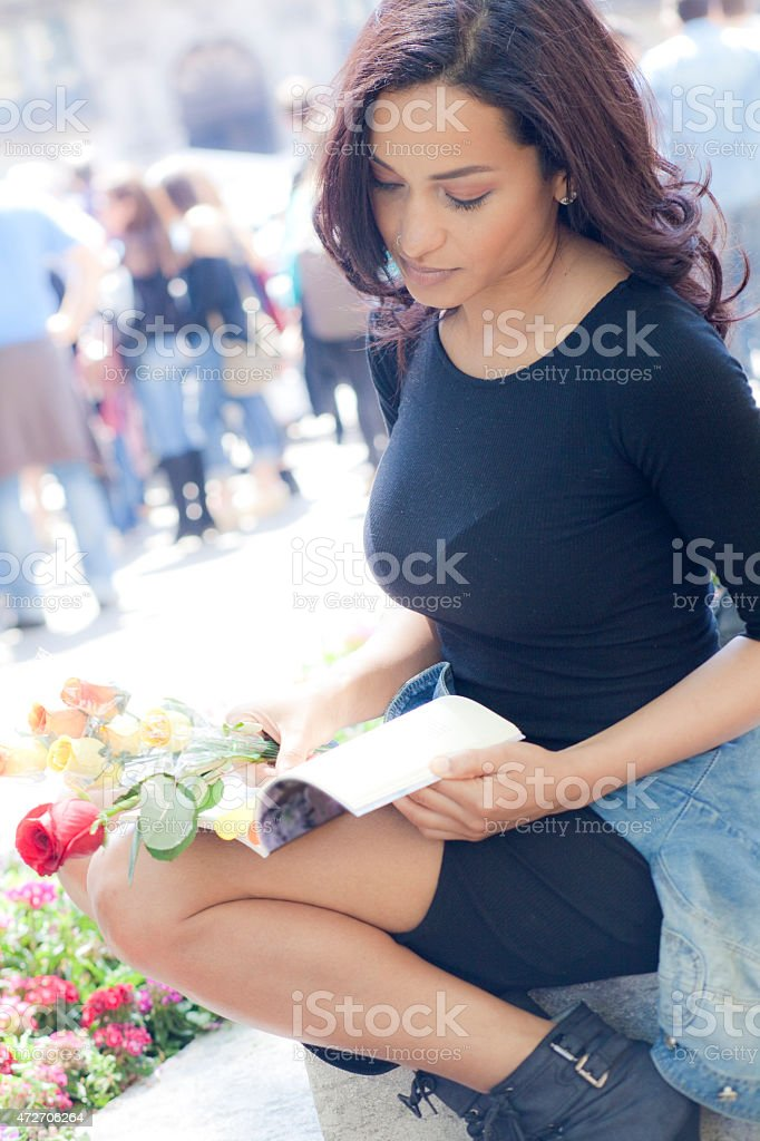 Sensual woman with rose and book stock photo