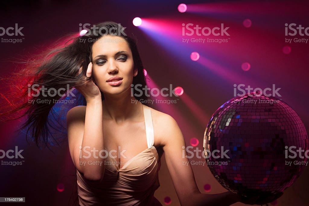 Sensual women looking on disco ball