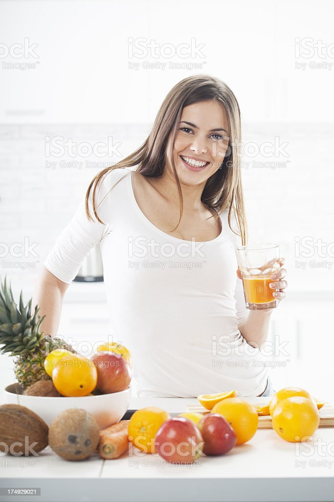 Sensual Young Woman Drinking Orange Juice royalty-free stock photo