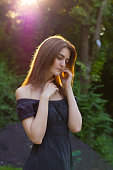 Sensual young woman in a rays of sun