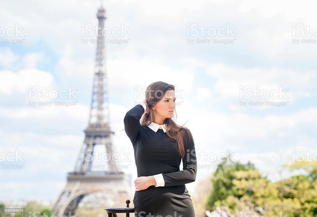 Sensual Young Woman near Eiffel Tower in Paris stock photo