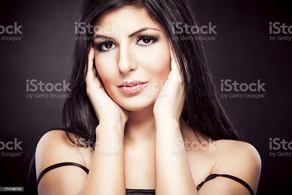 Sensual young woman on dark background royalty-free stock photo