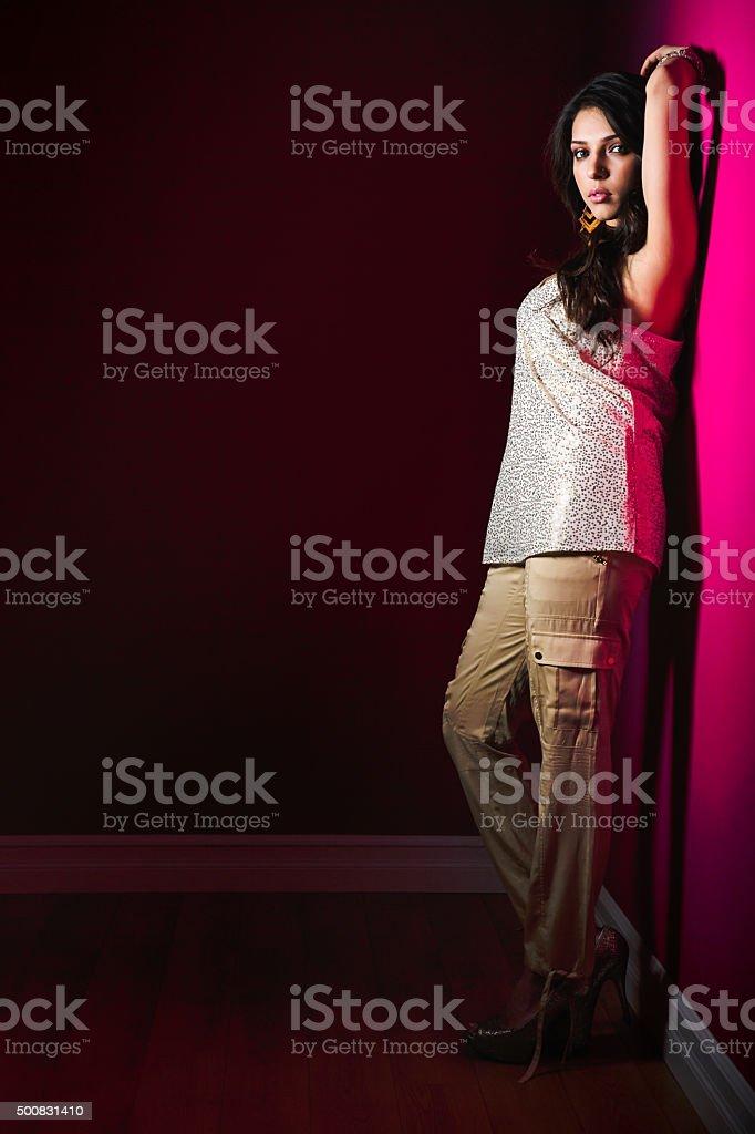 Sensual young woman posing in dark stock photo