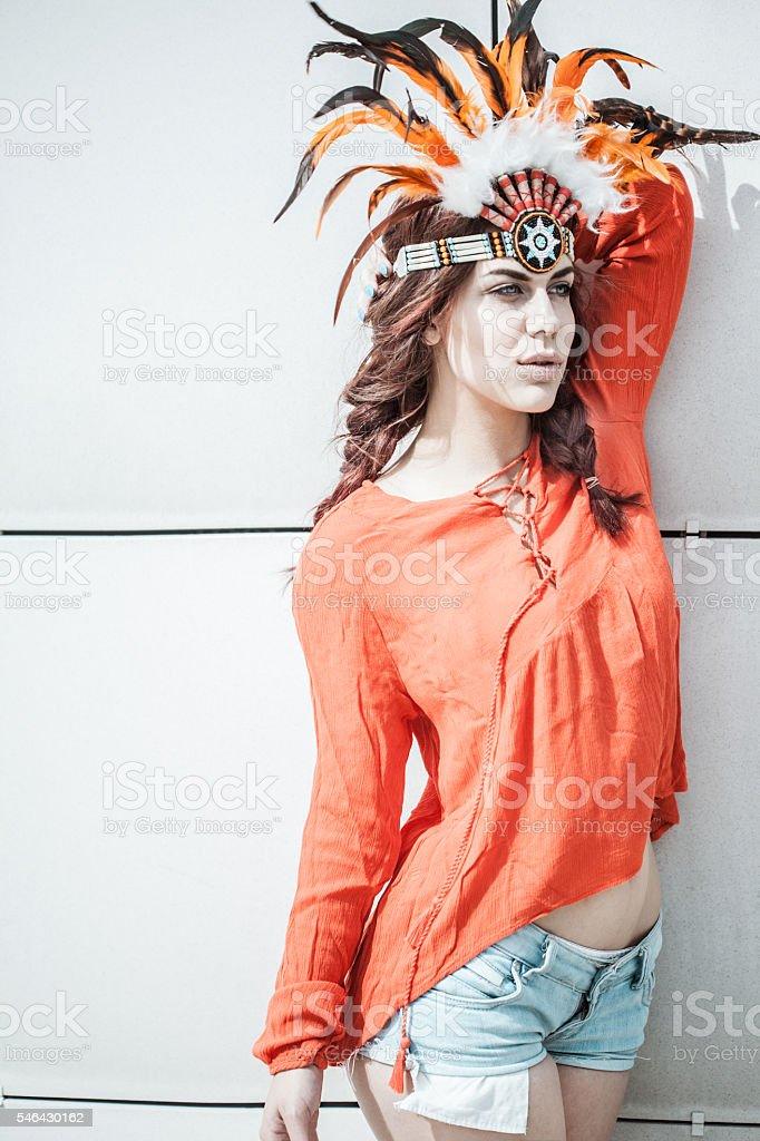 Sensual young woman wearing indian headdress stock photo