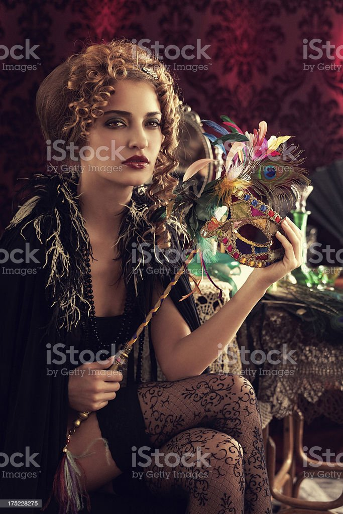 Sensual young woman with venetian mask royalty-free stock photo