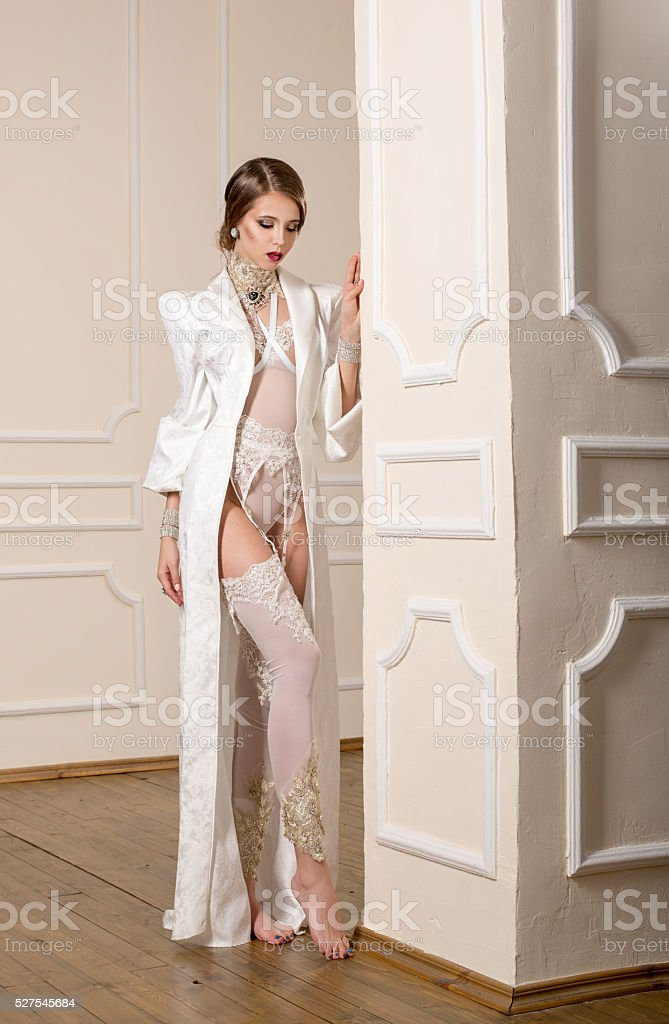 Sensuality woman in white robe and underwear stock photo