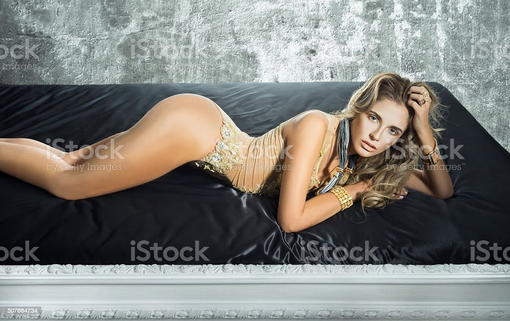 Sensuality woman lying in the bed stock photo