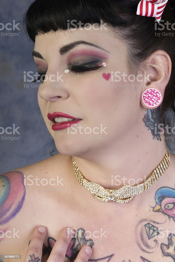 Sensuous portrait of woman in rhinestone choker and tattooes. royalty-free stock photo