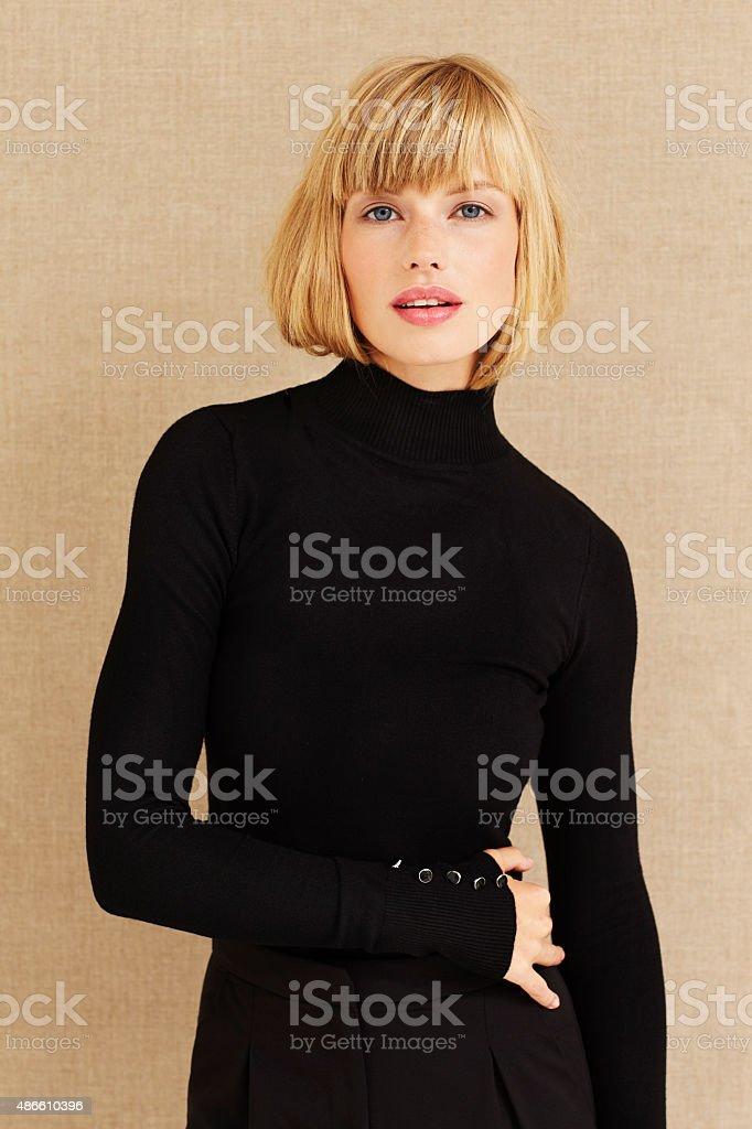 Sensuous young woman in studio stock photo