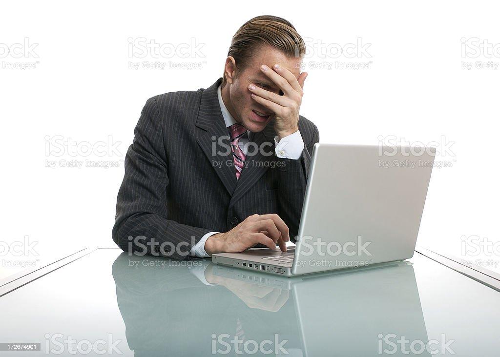 I Sent It?! Bad News Businessman Shielding Eyes at Desk royalty-free stock photo