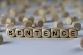 sentence - cube with letters, sign with wooden cubes