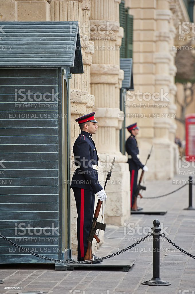 Sentries on guard duty outside the Grandmasters Palace, Valletta, Malta royalty-free stock photo