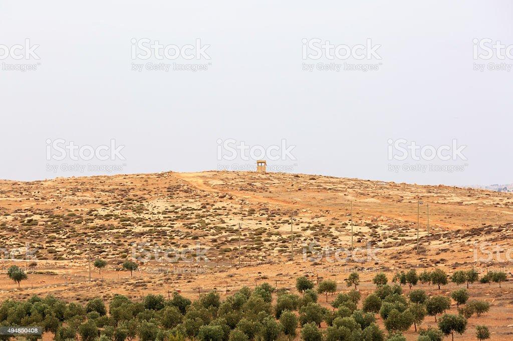 Sentry box on a hill, near an olive grove stock photo