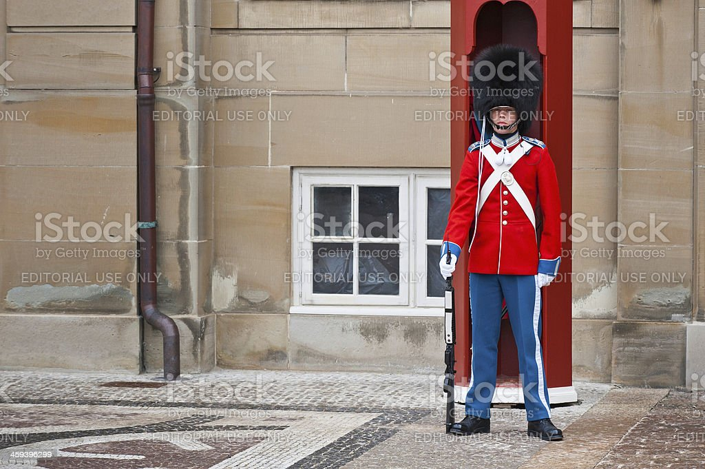 Sentry standing guard in colourful uniform stock photo