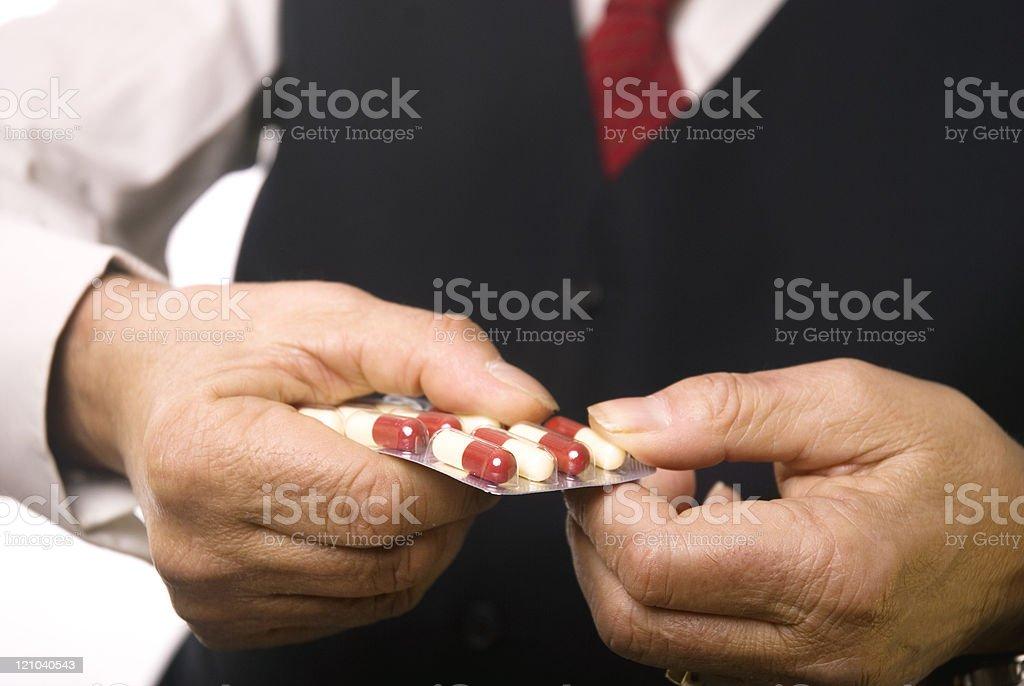 Senuior man taking medicine royalty-free stock photo