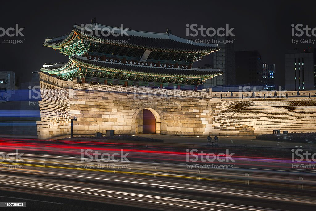 Seoul Korea Namdaemun Gate traffic lights zooming past at night royalty-free stock photo