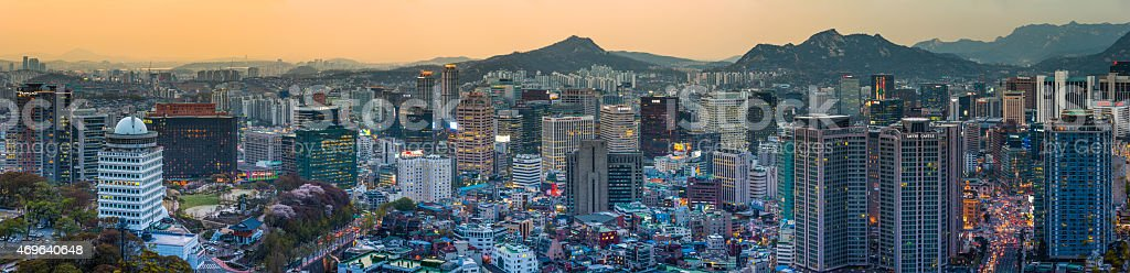 Seoul neon lights crowded cityscape panorama over downtown sunset Korea stock photo
