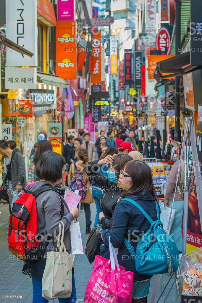 Seoul shoppers in crowded downtown shopping street Myeong-Dong South Korea royalty-free stock photo