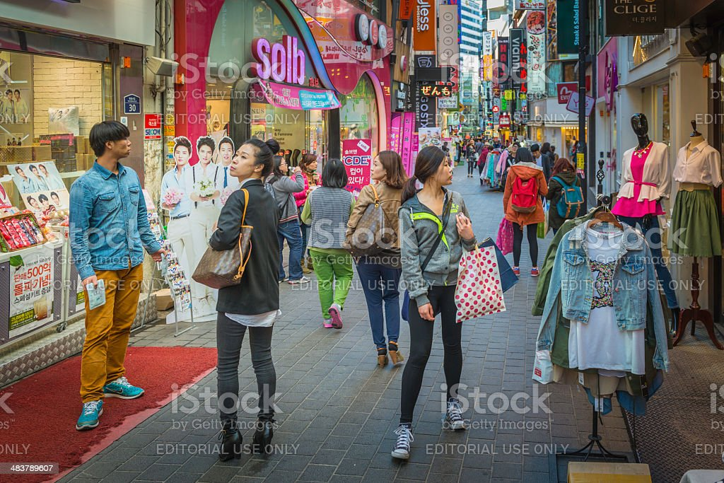Seoul South Korea shoppers in busy pedestrianised shopping street Myeong-Dong stock photo