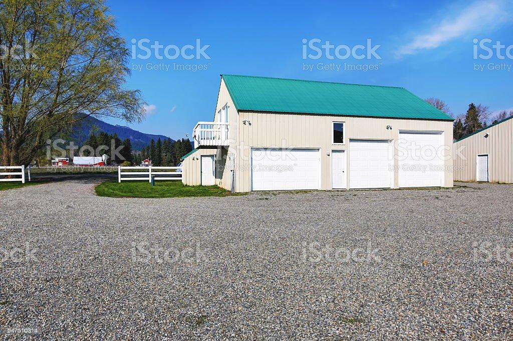 Separate garage building with three garage doors stock photo