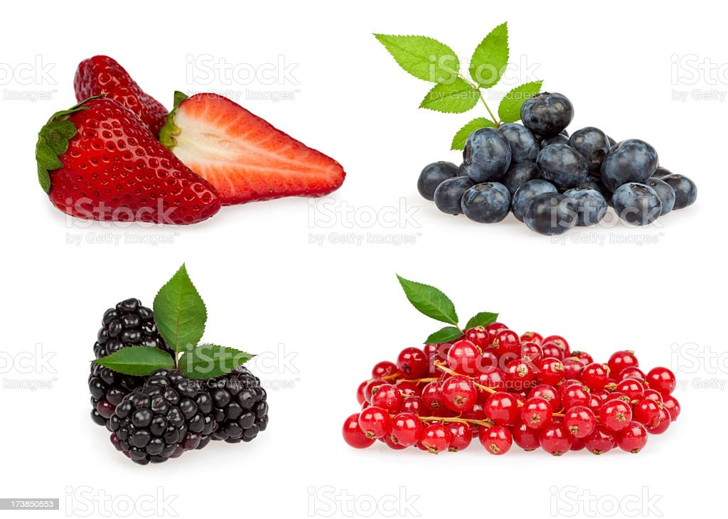 Separate pile of red and blue berries isolated on white royalty-free stock photo