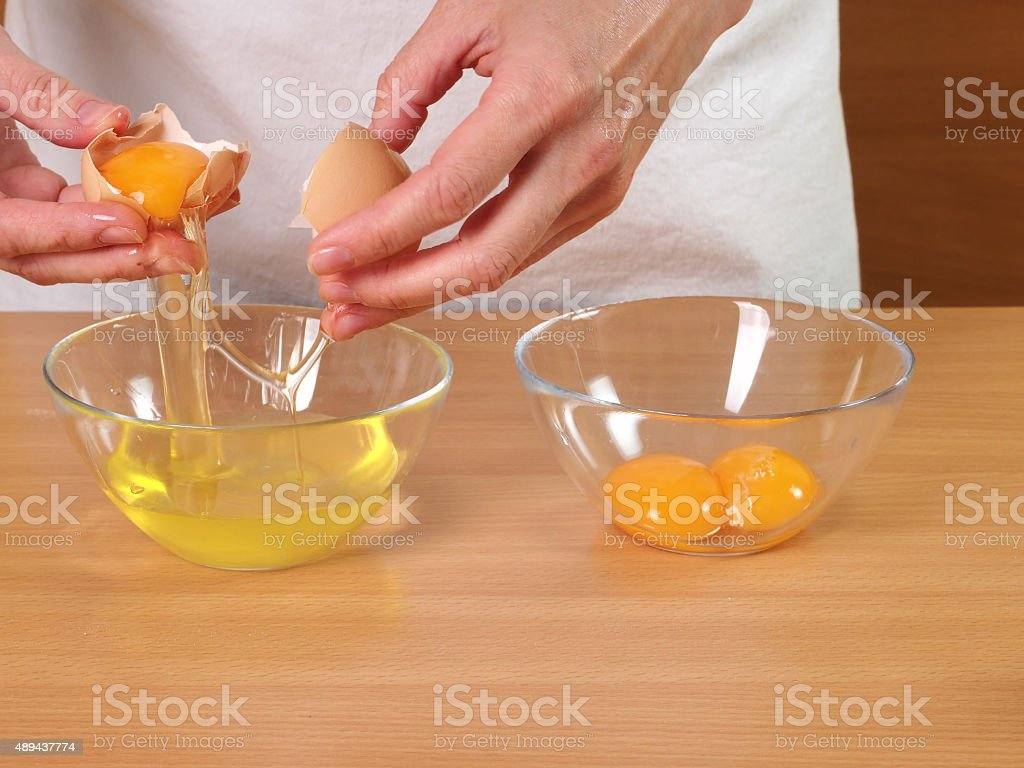 Separating egg yolk from white stock photo
