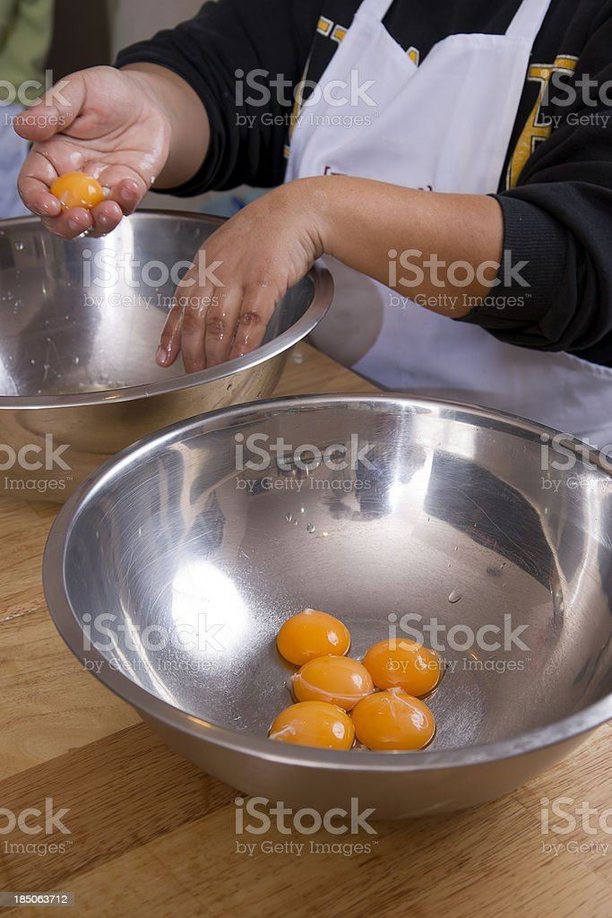 Separating Egg Yolks royalty-free stock photo