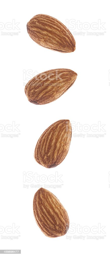 Seperated almonds on white backround royalty-free stock photo