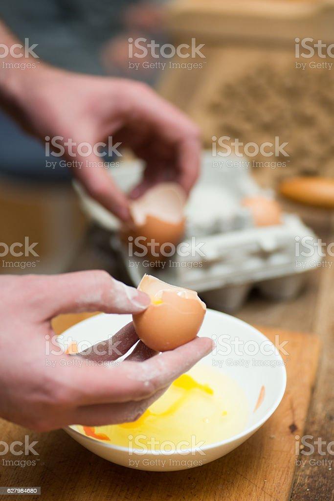 seperating egg yolk - Eier trennen stock photo