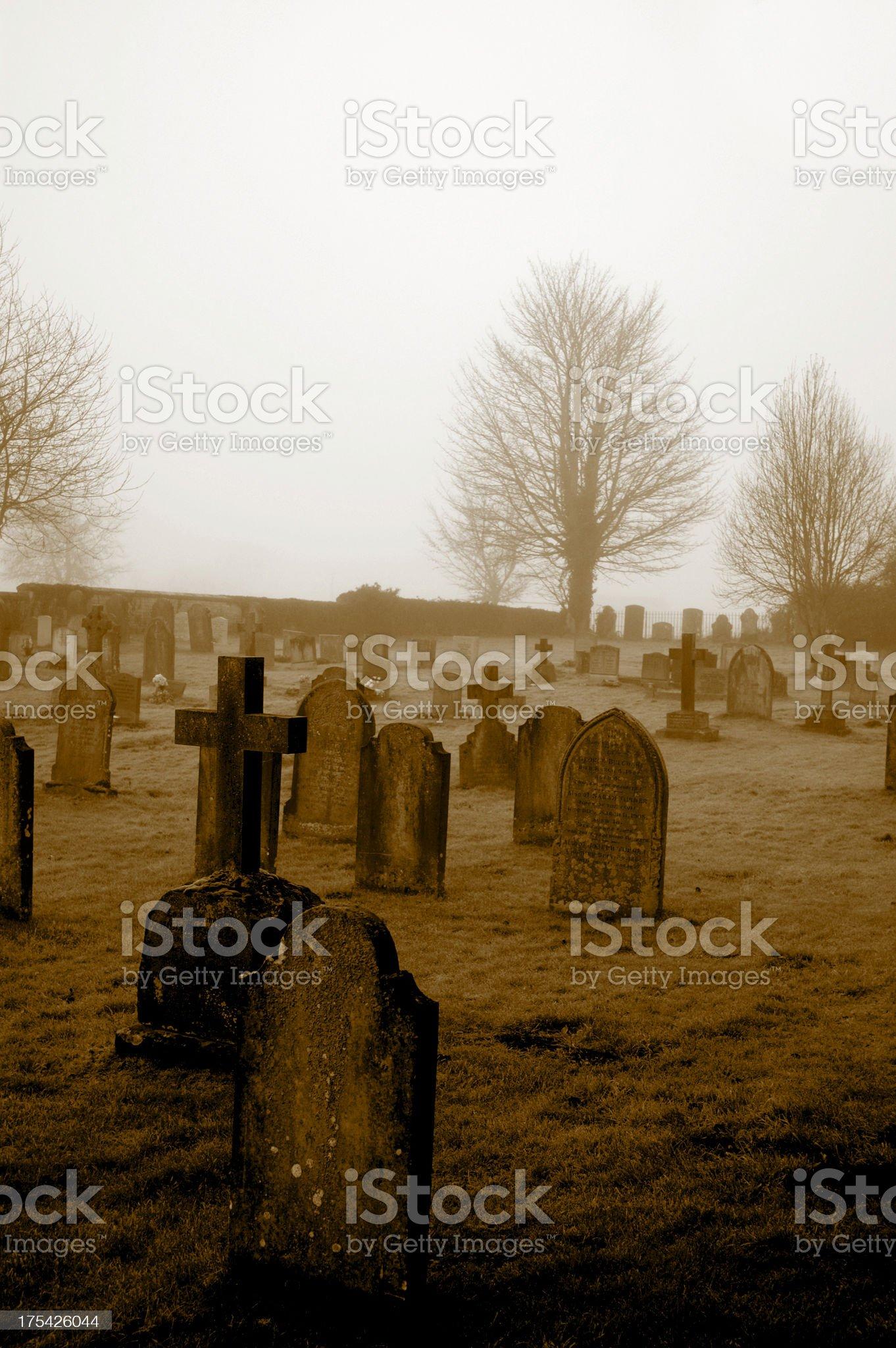 Sepia graveyard, misty morning royalty-free stock photo