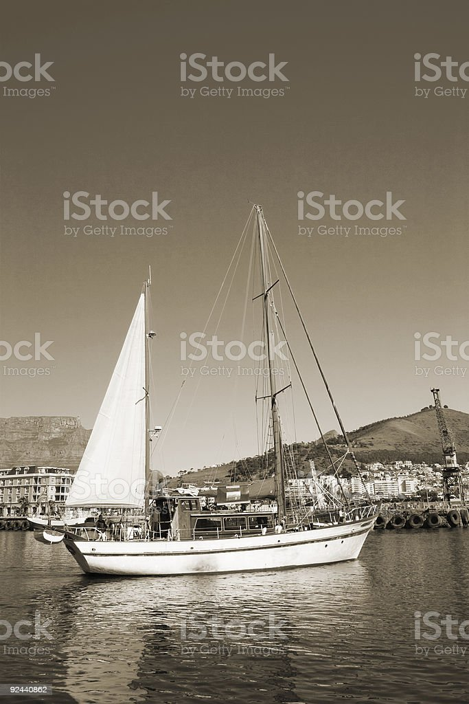 Sepia image of a yacht on the water royalty-free stock photo